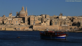 Carmelite Dome & St Paul's Anglican Cathedral and Valletta from Sliema